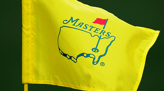 Golfer looks on at the masters tournament flag