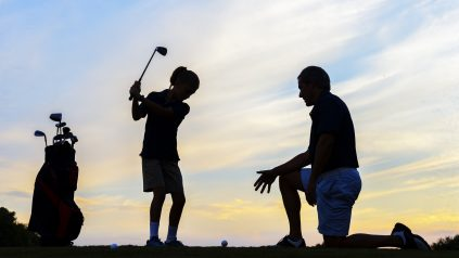 children playing golf